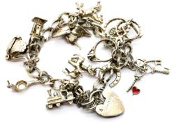 Silver charm bracelet with twelve charms, 27g. P&P Group 1 (£14+VAT for the first lot and £1+VAT for