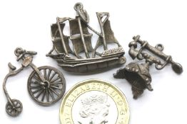 Three vintage silver assorted charms. P&P Group 1 (£14+VAT for the first lot and £1+VAT for