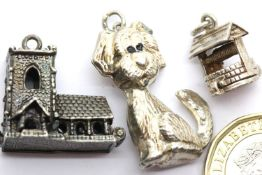 Three 70s vintage silver charms, Church, well and dog. P&P Group 1 (£14+VAT for the first lot and £