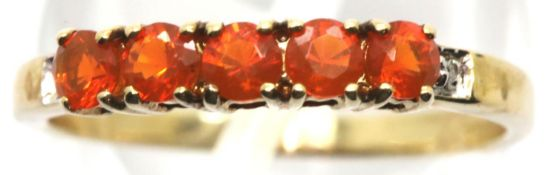 9ct gold ring with five orange stones and diamonds, size O, 1.6g. P&P Group 1 (£14+VAT for the first