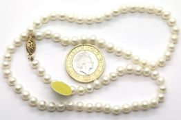 Ladies natural pearl necklace with 9ct gold fancy clasp. P&P Group 1 (£14+VAT for the first lot
