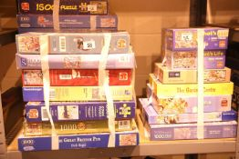 Large quantity of assorted boxed jigsaws, approximately 24 in total. Not available for in-house P&P