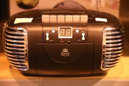 Black 3 in 1 FM/AM radio, CD and cassette player, boxed GPO PCD299. Not available for in-house P&P