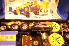 Plastic tool box of various bits of Meccano and modeling books 1, 4 and 5. Not available for in-