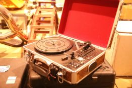 Walnut effect briefcase 3 speed turntable; USB recored in built in twin stereo speakers; RCA