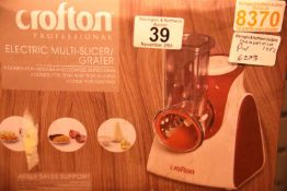 Two boxed crofton electric multi slicer/graters. Not available for in-house P&P