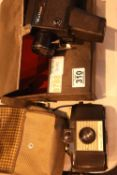 Cased Kodak 127 camera and a Halina hand held Super 8 cine camera. Not available for in-house P&P