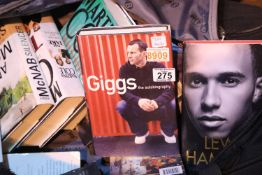 Black holdall containing a quantity of hardback volumes including autobiographies, Ryan Giggs, Lewis