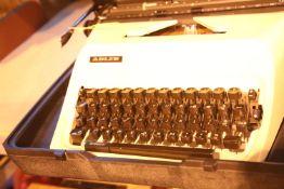 Plastic cased Adler typewriter. Not available for in-house P&P