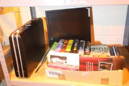 Box of mixed items including books, PC monitor and an attache case. Not available for in-house P&P