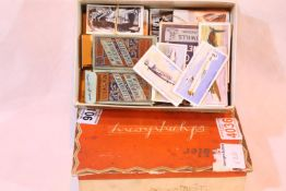 Box containing a small collection of vintage cigarette cards. P&P Group 1 (£14+VAT for the first lot