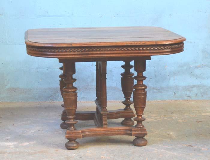 Lot 26 - *OAK HENRI II STYLE TABLE. CIRCA 1900