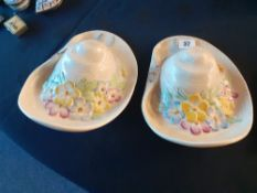 A pair of Beswick wall pockets in the shape of floral straw hats.