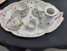 A Herand Hungary porcelain cabaret coffee set hand painted with flowers.