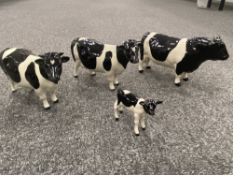 A Beswick model of bull two cows and a calf etc 6 items,