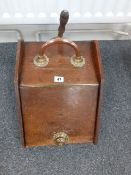 A Victorian oak coal box with copper and brass handles/shovel