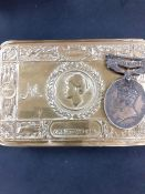 A WW1 brass chocolate tin 1914 together with a territorial medal.