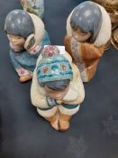 A three Ladro figures of indigenous people.