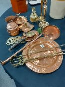 A pair of brass candlesticks and a collection of brass and copperware aprox 17 items