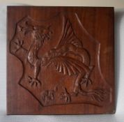 "A Mahogany wall plaque with a carved dragon 19.5"" square"