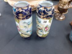 A pair of Nipon china hand painted vases (one chipped)