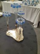 An Edwardian silver plated epergne with clear and blue glass trumpets.