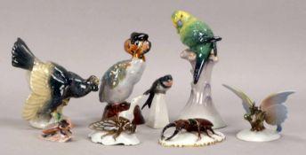 Konvolut Porzellan-Tierfiguren, verschiedene Ausführungen, jeweils farbig gefasst, 9 Stück (darunter
