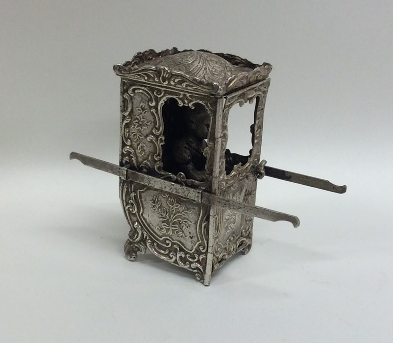 Lot 4 - A Continental silver model of a sedan chair. Appro