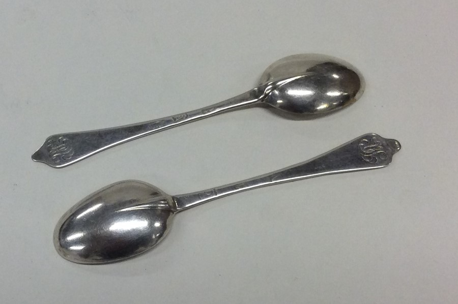Lot 31 - A pair of Queen Anne dog nose and rat tail spoons.