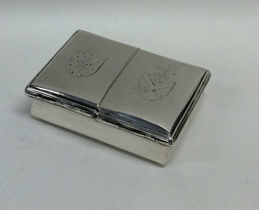 Lot 32 - A rare double sided hinged top silver snuff box wi