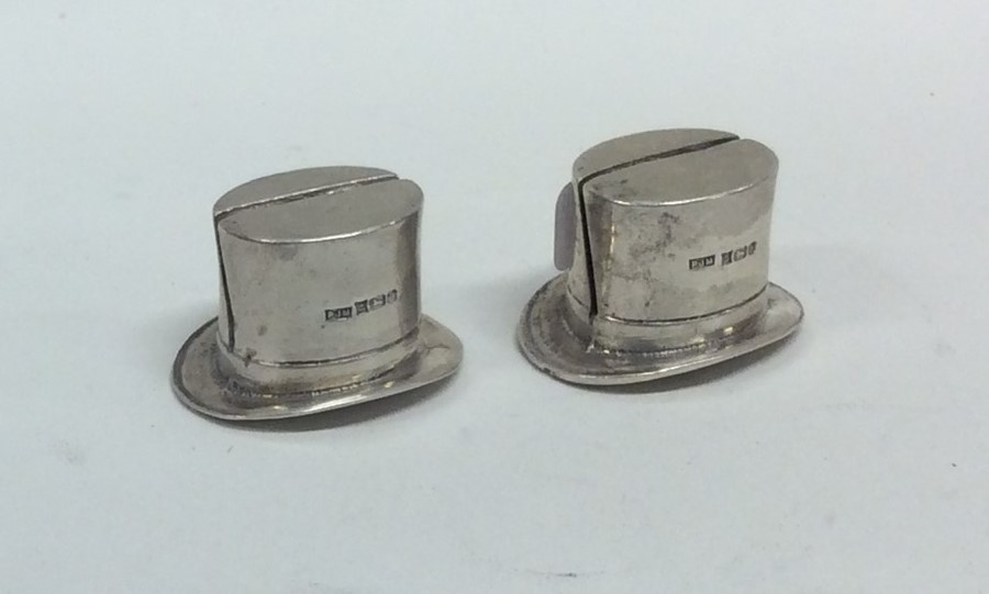 Lot 50 - A pair of novelty silver menu holders in the form