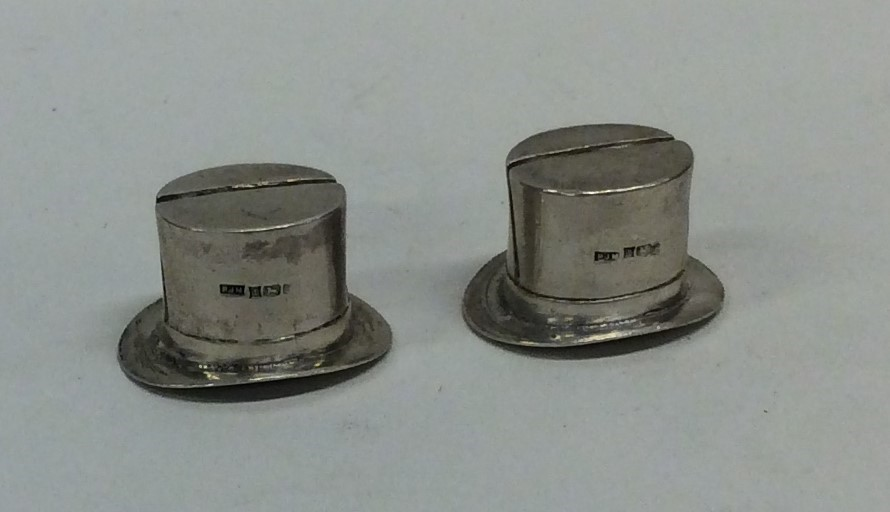 Lot 49 - A pair of novelty silver menu holders in the form