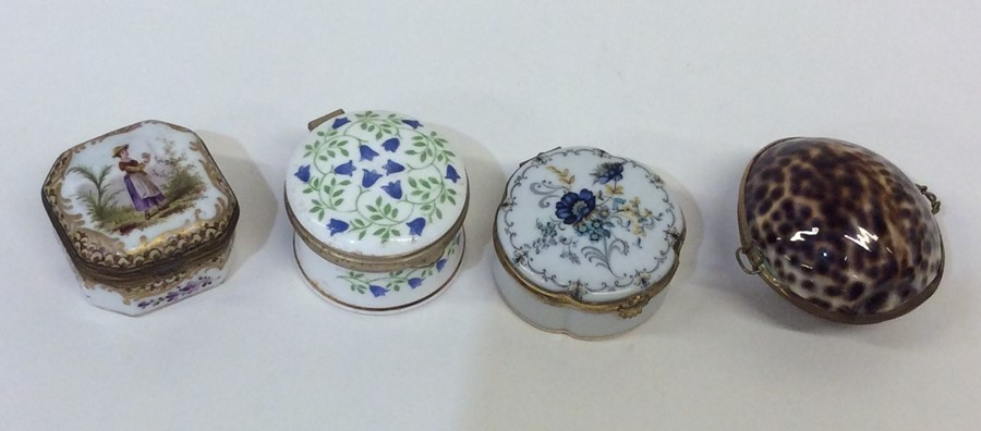 Lot 9 - A Limoges snuff box decorated with flowers togethe