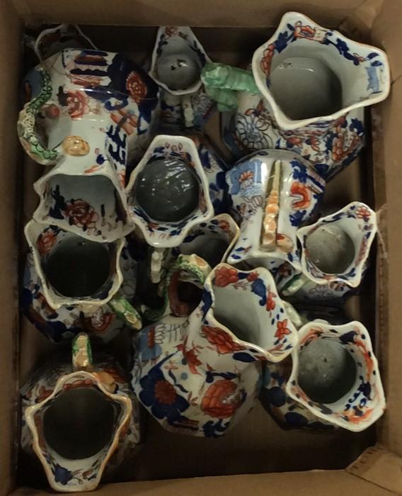 Lot 5 - A good set of graduated Masons Ironstone jugs. Est