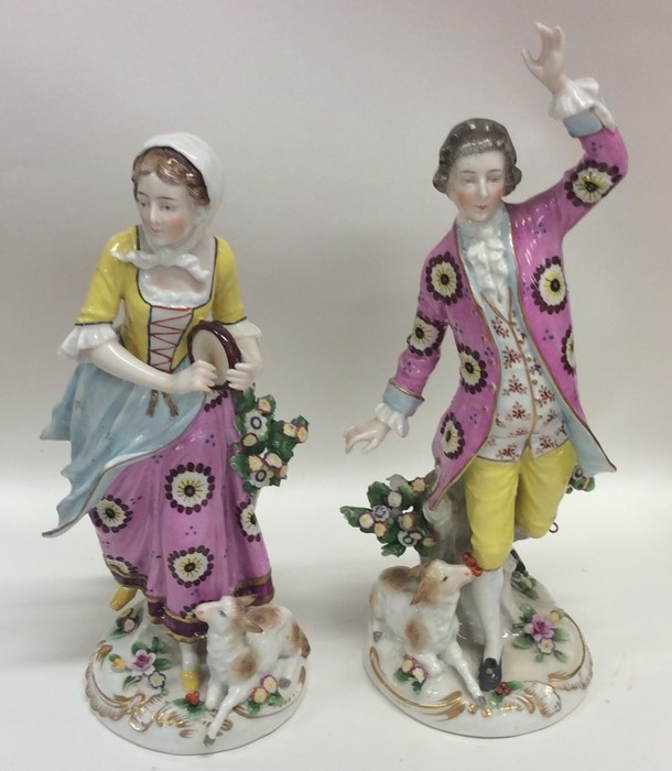 Lot 26 - A pair of attractive and decorative porcelain figu