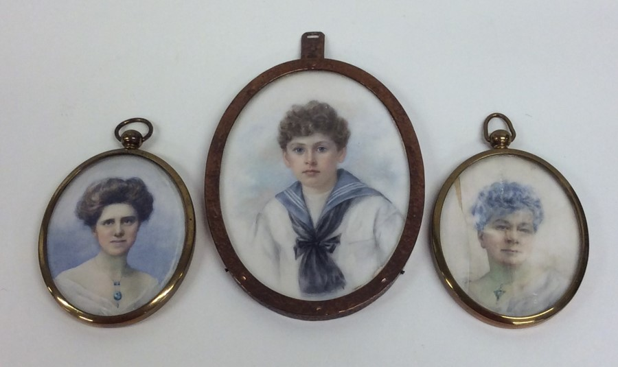 Lot 3 - An oval miniature depicting a boy together with tw