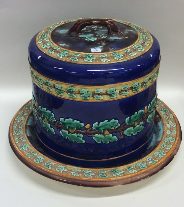 Lot 38 - A large majolica cheese dome decorated with acorns