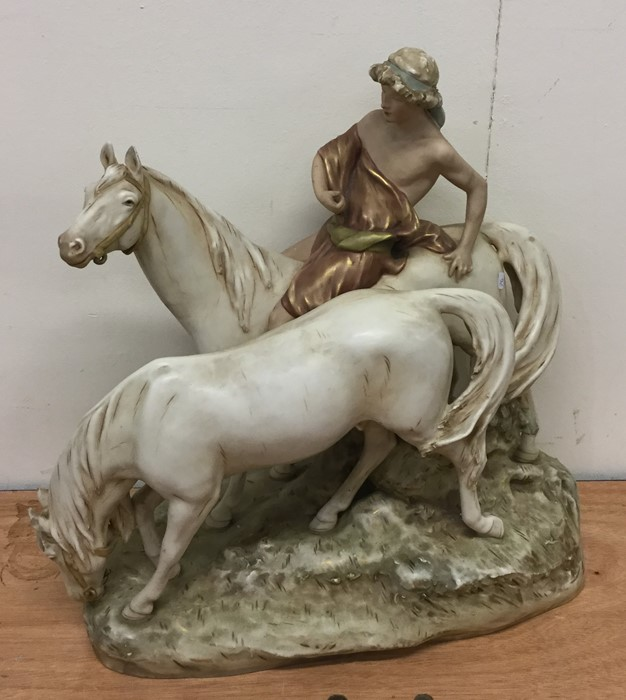 Lot 44 - A massive Royal Dux figure of horses and rider on