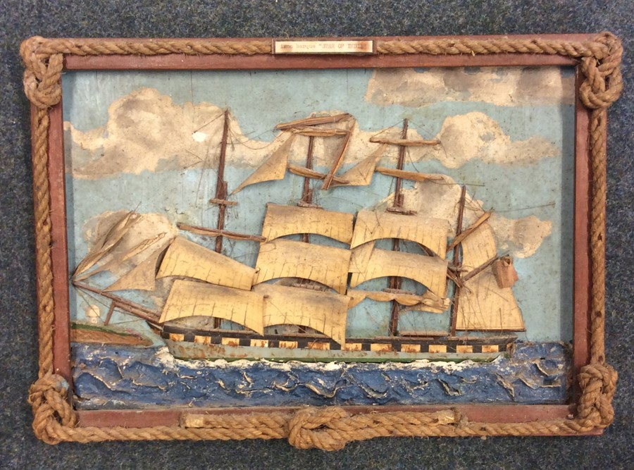Lot 16 - An unusual framed picture of a ship under sail in