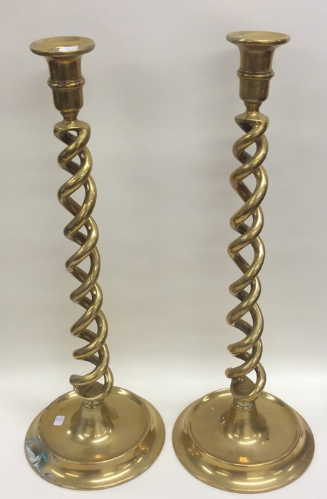 Lot 31 - A tall massive pair of brass candlesticks of barle