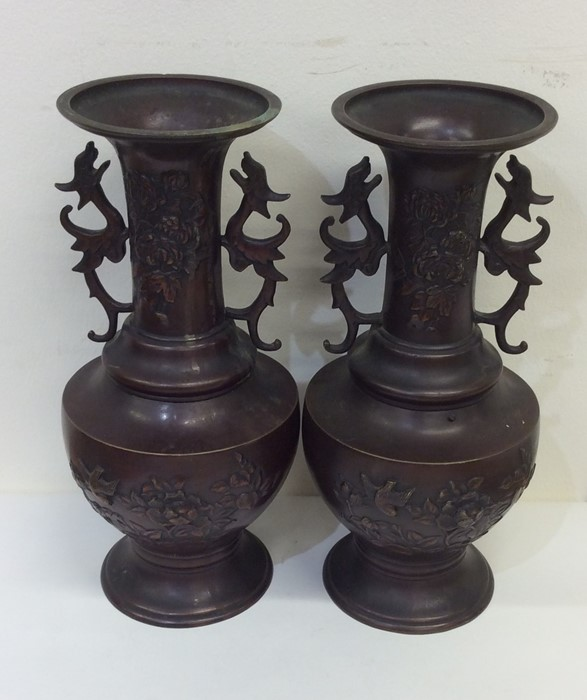 Lot 7 - A pair of tall Japanese bronze vases with floral d