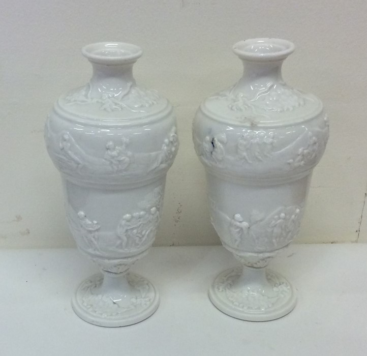 Lot 41 - A pair of good white glazed vases decorated with f