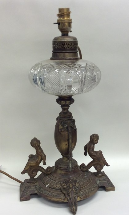 Lot 30 - A cut glass mounted oil lamp, the base decorated w