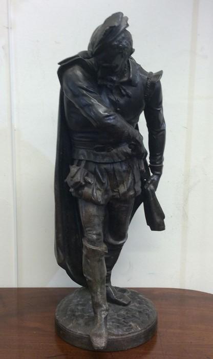 Lot 23 - A large spelter figure of a Tudor gentleman on cir