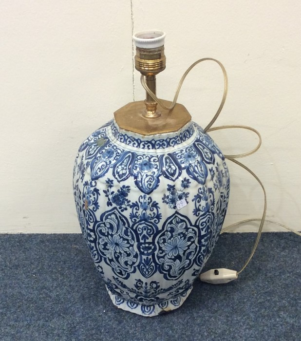 Lot 29 - A large blue and white Dutch vase mounted as a lam
