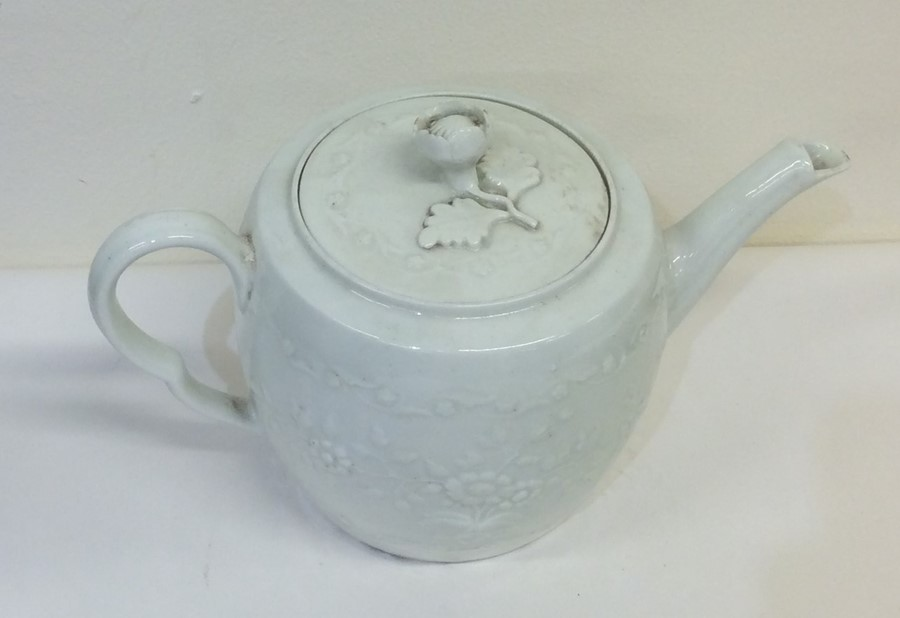 Lot 40 - An 18th Century white glazed barrel shaped teapot