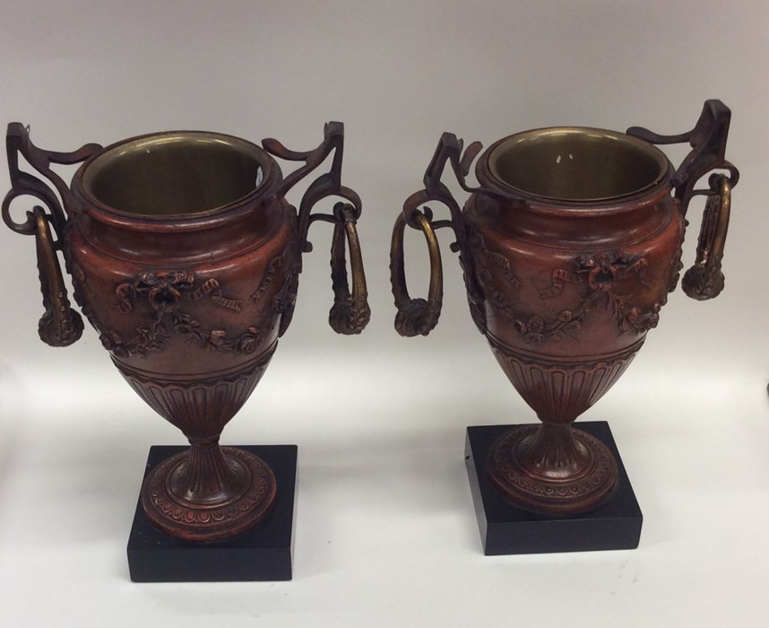 Lot 36 - A pair of attractive bronze urns mounted with stag