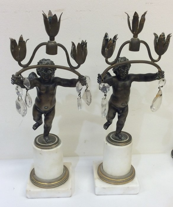 Lot 20 - A pair of French candlesticks decorated with cheru