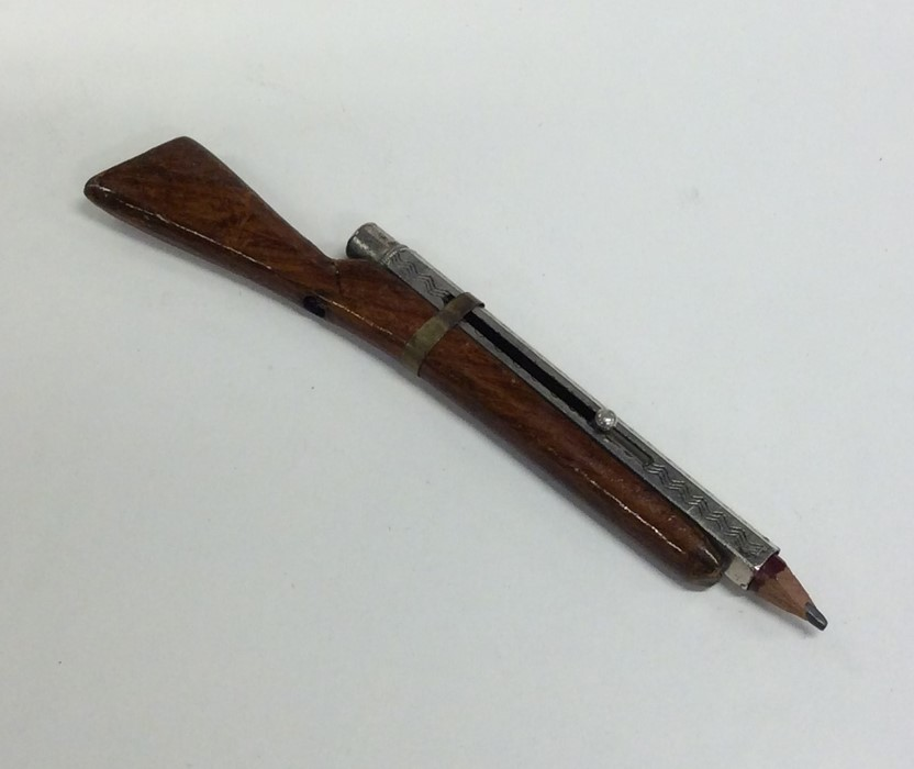 Lot 36 - A novelty silver plated extending pencil in the fo