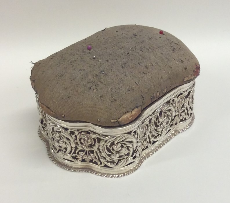 Lot 21 - A large silver pin cushion / jewellery box with sh